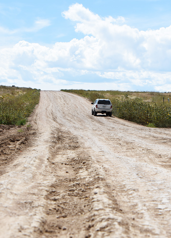 Peggy Crippen drives her Jeep Grand Cherokee up High Plains View, once of the worst roads in the Pioneer Village development, on Thursday, Sept. 14, 2017. After the Pioneer Village Public Improvement District had High Plains View regraded, the road returned to worse than their original condition after about a week.<br /> <br /> (The Gazette, Nadav Soroker)