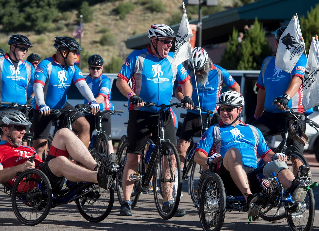 Mike Danielson, center, laughs as Shawn Seguin, left, and Steve Dabroski joke while saddling up for a Soldier Ride through Colorado Springs, Colo. on Friday, Sept. 15, 2017. Thirty five veterans from across the country took part in the two-day ride organized by the Wounded Warrior Project.<br />  <br /> (The Gazette, Nadav Soroker)