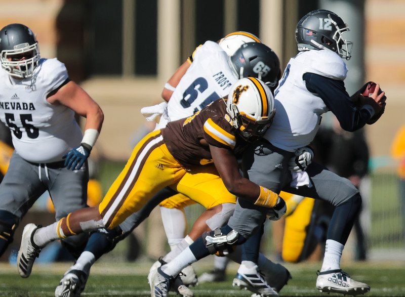Cowboys defensive end Solomon Byrd cruises in for a sack against Nevada quarterback Carson Strong as the Wyoming Cowboys take on the Nevada Wolf Pack Saturday, Oct. 26, 2019 at War Memorial Stadium. Wyoming defeated Nevada 31-3. Nadav Soroker/Wyoming Tribune Eagle