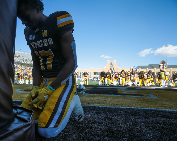Cowboys wide receiver Raghib Ismail Jr. prays against the uprights at the south endzone as the Wyoming Cowboys prepare to take on the Nevada Wolf Pack Saturday, Oct. 26, 2019 at War Memorial Stadium. Nadav Soroker/Wyoming Tribune Eagle