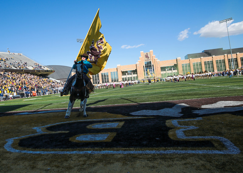 The Wyoming Cowboys charge on to the field to take on the Nevada Wolf Pack Saturday, Oct. 26, 2019 at War Memorial Stadium. Nadav Soroker/Wyoming Tribune Eagle