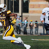 Cowboys wide receiver Raghib Ismail Jr. runs the ball through a hole made by the line as the Wyoming Cowboys prepare to take on the Nevada Wolf Pack Saturday, Oct. 26, 2019 at War Memorial Stadium. Nadav Soroker/Wyoming Tribune Eagle