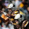 Cowboys quarter back Sean Chambers takes the snap as the Wyoming Cowboys take on the Nevada Wolf Pack Saturday, Oct. 26, 2019 at War Memorial Stadium. Wyoming defeated Nevada 31-3. Nadav Soroker/Wyoming Tribune Eagle