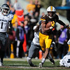 Cowboys running back Xazavian Valladay (6) dodges a Wolf Pack defender as the Wyoming Cowboys take on the Nevada Wolf Pack Saturday, Oct. 26, 2019 at War Memorial Stadium. Wyoming defeated Nevada 31-3. Nadav Soroker/Wyoming Tribune Eagle