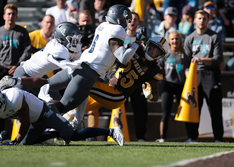 Cowboys wide receiver Austin Conway tries to make it over the line as the Wyoming Cowboys take on the Nevada Wolf Pack Saturday, Oct. 26, 2019 at War Memorial Stadium. Wyoming defeated Nevada 31-3. Nadav Soroker/Wyoming Tribune Eagle