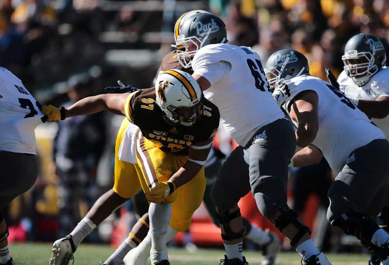 Cowboys defensive tackle Mario Mora fights through the line as the Wyoming Cowboys take on the Nevada Wolf Pack Saturday, Oct. 26, 2019 at War Memorial Stadium. Wyoming defeated Nevada 31-3. Nadav Soroker/Wyoming Tribune Eagle