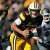 Cowboys quarter back Sean Chambers scrambles with the ball as the Wyoming Cowboys take on the Nevada Wolf Pack Saturday, Oct. 26, 2019 at War Memorial Stadium. Wyoming defeated Nevada 31-3. Nadav Soroker/Wyoming Tribune Eagle