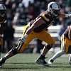 Cowboys offensive tackle Frank Crum charges into the line as the Wyoming Cowboys take on the Nevada Wolf Pack Saturday, Oct. 26, 2019 at War Memorial Stadium. Wyoming defeated Nevada 31-3. Nadav Soroker/Wyoming Tribune Eagle