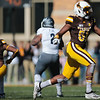 Cowboys defensive end Solomon Byrd celebrates a sack against Nevada quarterback Carson Strong as the Wyoming Cowboys take on the Nevada Wolf Pack Saturday, Oct. 26, 2019 at War Memorial Stadium. Wyoming defeated Nevada 31-3. Nadav Soroker/Wyoming Tribune Eagle