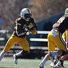 Cowboys running back Xazavian Valladay (6) looks for an opening as the Wyoming Cowboys take on the Nevada Wolf Pack Saturday, Oct. 26, 2019 at War Memorial Stadium. Wyoming defeated Nevada 31-3. Nadav Soroker/Wyoming Tribune Eagle