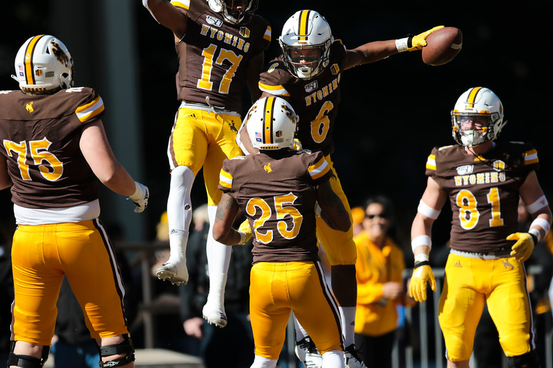 Cowboys running back Xazavian Valladay (6) cheers his touchdown with his teammates as the Wyoming Cowboys take on the Nevada Wolf Pack Saturday, Oct. 26, 2019 at War Memorial Stadium. Wyoming defeated Nevada 31-3. Nadav Soroker/Wyoming Tribune Eagle