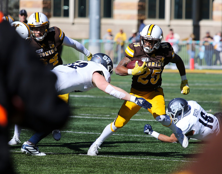 Cowboys wide receiver Austin Conway dodges through an opening as the Wyoming Cowboys take on the Nevada Wolf Pack Saturday, Oct. 26, 2019 at War Memorial Stadium. Wyoming defeated Nevada 31-3. Nadav Soroker/Wyoming Tribune Eagle