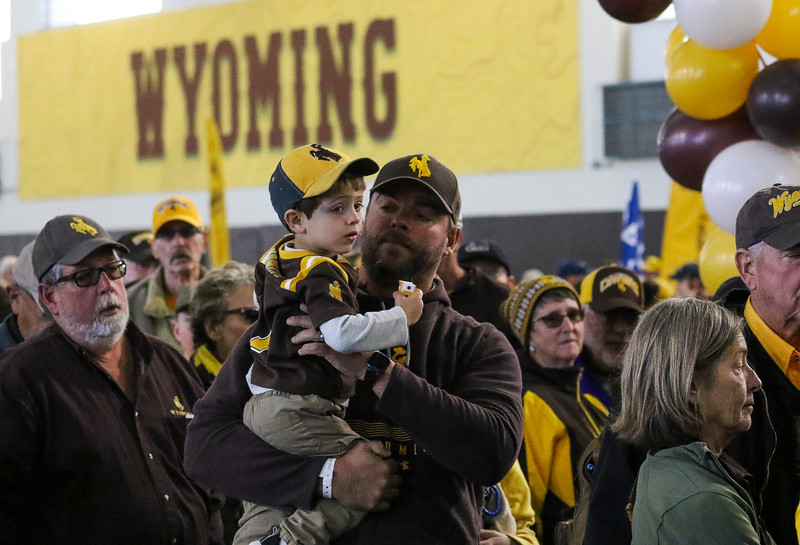 Ryan Rapp holds up Jaxson Rapp, 3, as they wait in line at the Cowboy Joe Club as the Wyoming Cowboys prepare to take on the Nevada Wolf Pack Saturday, Oct. 26, 2019 at War Memorial Stadium. Nadav Soroker/Wyoming Tribune Eagle