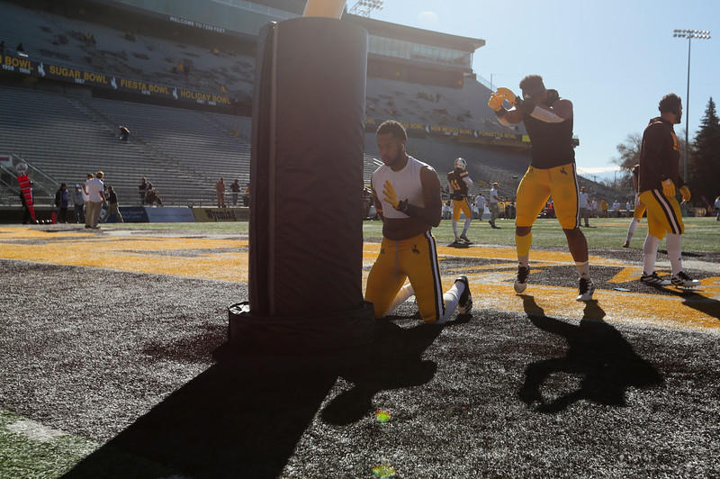 Cowboys players warm up in the north end zone as fans filter in to cheer as the Wyoming Cowboys prepare to take on the Nevada Wolf Pack Saturday, Oct. 26, 2019 at War Memorial Stadium. Nadav Soroker/Wyoming Tribune Eagle