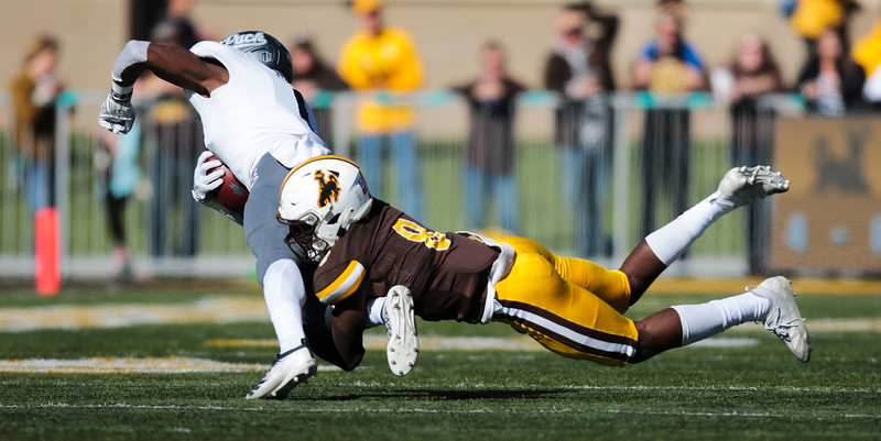 Cowboys free safety Rome Weber drags down a Wolf Pack receiver as the Wyoming Cowboys take on the Nevada Wolf Pack Saturday, Oct. 26, 2019 at War Memorial Stadium. Wyoming defeated Nevada 31-3. Nadav Soroker/Wyoming Tribune Eagle
