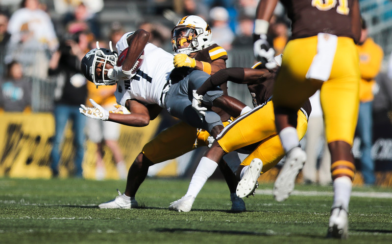 Cowboys corner back Tyler Hall hauls Wolf Pack wide receiver Romeo Doubs to the down to the turf as the Wyoming Cowboys take on the Nevada Wolf Pack Saturday, Oct. 26, 2019 at War Memorial Stadium. Wyoming defeated Nevada 31-3. Nadav Soroker/Wyoming Tribune Eagle