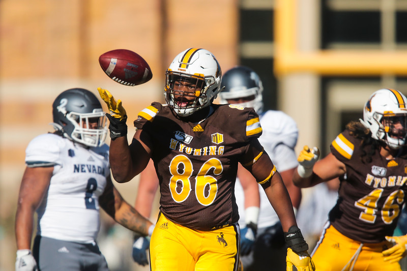 Cowboys defensive tackle Javaree Jackson tosses the football after assisting in a sack as the Wyoming Cowboys take on the Nevada Wolf Pack Saturday, Oct. 26, 2019 at War Memorial Stadium. Wyoming defeated Nevada 31-3. Nadav Soroker/Wyoming Tribune Eagle