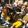 A tangle of Cowboys stop Wolf Pack quarterback Cristian Solano's scramble mid-air as the Wyoming Cowboys take on the Nevada Wolf Pack Saturday, Oct. 26, 2019 at War Memorial Stadium. Wyoming defeated Nevada 31-3. Nadav Soroker/Wyoming Tribune Eagle