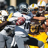 Cowboys strong safety Alijah Halliburton comes up behind Wolf Pack quarterback Cristian Solano for a sack as the Wyoming Cowboys take on the Nevada Wolf Pack Saturday, Oct. 26, 2019 at War Memorial Stadium. Wyoming defeated Nevada 31-3. Nadav Soroker/Wyoming Tribune Eagle