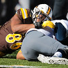 Cowboys defensive tackle Javaree Jackson drags down Wolf Pack quarterback Carson Strong as the Wyoming Cowboys take on the Nevada Wolf Pack Saturday, Oct. 26, 2019 at War Memorial Stadium. Wyoming defeated Nevada 31-3. Nadav Soroker/Wyoming Tribune Eagle