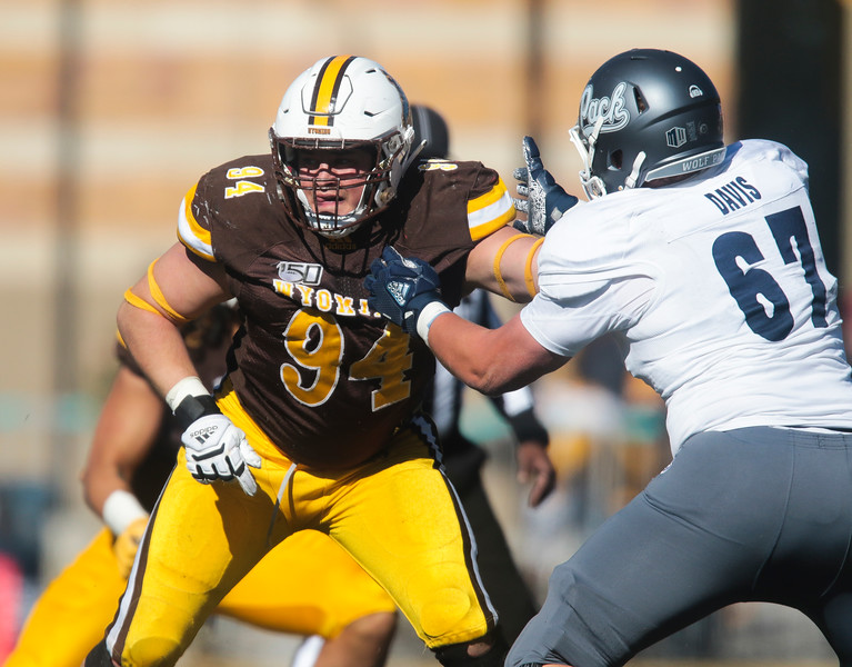 Cowboys defensive tackle Cole Godbout fends off Wolf Pack offensive lineman Gray Davis as the Wyoming Cowboys take on the Nevada Wolf Pack Saturday, Oct. 26, 2019 at War Memorial Stadium. Wyoming defeated Nevada 31-3. Nadav Soroker/Wyoming Tribune Eagle
