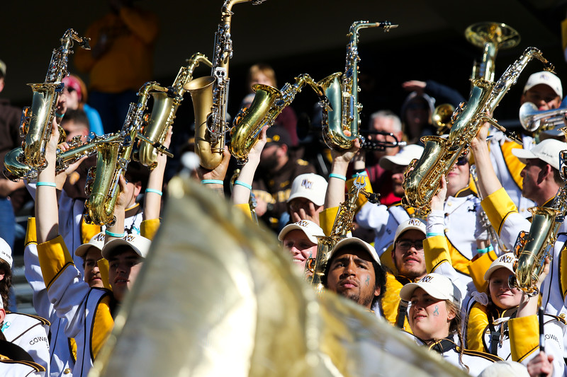 The Western Thunder Marching Band dances to Cotton Eye Joe as the Wyoming Cowboys defeat the Nevada Wolf Pack 31-3 Saturday, Oct. 26, 2019 at War Memorial Stadium. Nadav Soroker/Wyoming Tribune Eagle