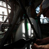 Phil Wright, the owner of Tower Clock Company, inspects the gears that turn the hands on the east face of the Depot Clock Tower Friday, September 13, 2019 in downtown Cheyenne. Nadav Soroker/Wyoming Tribune Eagle