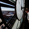 Glen Garrett looks out a missing pane in the west face of the Depot Clock Tower as workers repair the clock Friday, September 13, 2019 in downtown Cheyenne. Nadav Soroker/Wyoming Tribune Eagle