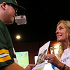Hunter Bjorgquist receives a notice from Sandi Riley, a wish granter, that he is the 600th Make-a-Wish recipient in Wyoming, Sunday, September 15, 2019 at Buffalo Wild Wings. Bjorgquist and his family will be making a trip to Wisconsin to meet the Green Bay Packers, his favorite team since he was a kid. Nadav Soroker/Wyoming Tribune Eagle