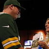Hunter Bjorgquist receives a notice from Sandi Riley, a wish giver, that he is the 600th Make-a-Wish recipient in Wyoming, Sunday, September 15, 2019 at Buffalo Wild Wings. Bjorgquist and his family will be making a trip to Wisconsin to meet the Green Bay Packers, his favorite team since he was a kid. Nadav Soroker/Wyoming Tribune Eagle