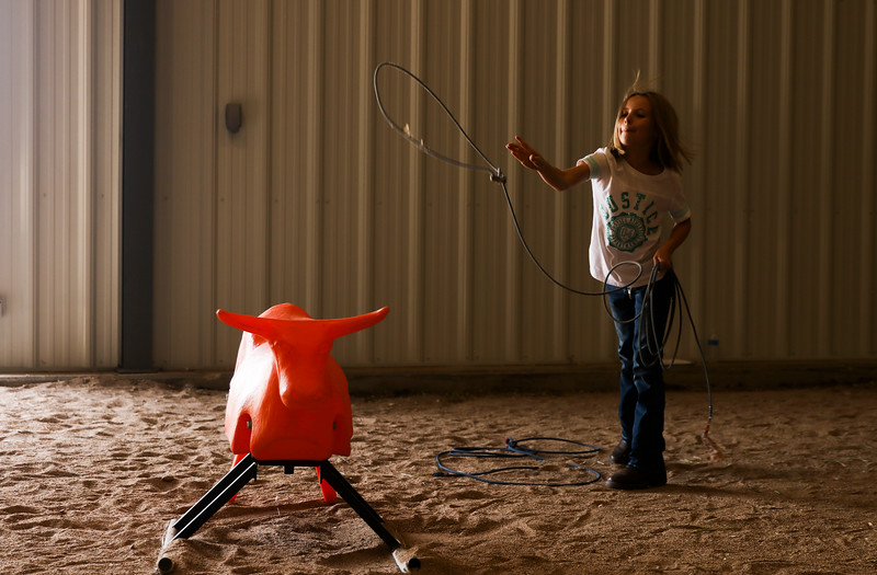 Tatum Reher, 9, practices lassoing a practice steer at the Laramie County Ag Expo which exposes fourth graders from all the Laramie County Schools to agriculture and where their food comes from Tuesday, September 17, 2019 at the Archer Complex.