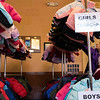Nita Barragan picks out jackets for her kids and some nieces and nephews at the Coats for Kids event Friday, October 4, 2019 at the Cheyenne Depot. Nadav Soroker/Wyoming Tribune Eagle