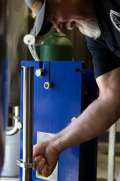 Head brewer Mitch Kunce cleans out the lines after brewing a Vienna Oatmeal Blonde Ale Tuesday, October 8, 2019 at The Library Sports Grille and Brewery.  Nadav Soroker/Laramie Boomerang