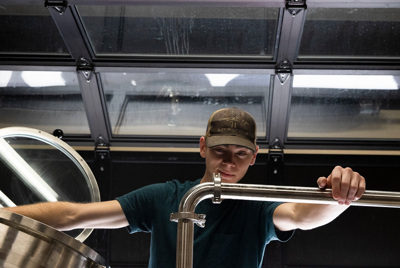 Assistant brewer Jake Bauer cleans out the boil kettle after brewing a Vienna Oatmeal Blonde Ale with head brewer Mitch Kunce Tuesday, October 8, 2019 at The Library Sports Grille and Brewery. Nadav Soroker/Laramie Boomerang
