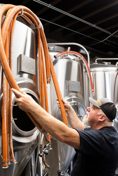 Head brewer Mitch Kunce cleans up and puts up hoses after brewing a Vienna Oatmeal Blonde Ale Tuesday, October 8, 2019 at The Library Sports Grille and Brewery.  Nadav Soroker/Laramie Boomerang