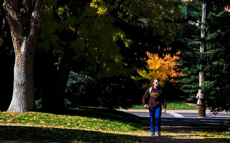 Luke Jensen, a sophomore Mechanical Engineering student, walks between classes Wednesday, October 9, 2019 at the University of Wyoming. Nadav Soroker/Laramie Boomerang
