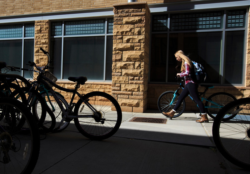 Deana Sadrieva, a freshman Chemical Engineering student, walks her bike back to the dorm after class Wednesday, October 9, 2019 at the University of Wyoming. Nadav Soroker/Laramie Boomerang