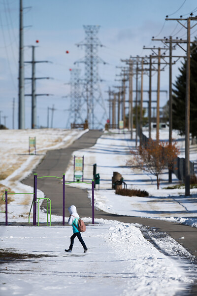 A kid walks across the snowy Greater Cheyenne Greenway Thursday, October 10, 2019 in south Cheyenne. Up to four inches of snow fell across Cheyenne according to the National Weather Service. Nadav Soroker/Wyoming Tribune Eagle