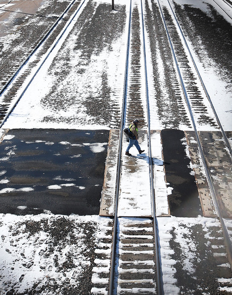A worker crosses the snowy tracks in the Union Pacific rail yard after the first snowfall of the season Thursday, October 10, 2019 in Cheyenne. Up to four inches of snow fell across Cheyenne according to the National Weather Service.  Nadav Soroker/Wyoming Tribune Eagle