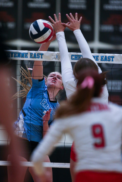 East sophomore Kiera Walsh (7) spikes against Central defenders Thursday, October 10, 2019 at the East High School Thunderdome. Cheyenne East High School Thunderbirds volleyball defeated the the Cheyenne Central High School Indians in straight sets. Nadav Soroker/Wyoming Tribune Eagle