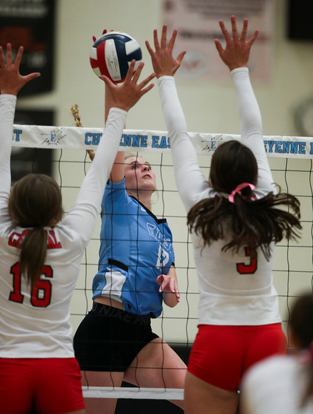 East senior Madison Blaney (12) tries to spike the ball past Central players Jordan Jones (16) and Ellie Fearneyhough (3) Thursday, October 10, 2019 at the East High School Thunderdome. Cheyenne East High School Thunderbirds volleyball defeated the the Cheyenne Central High School Indians in straight sets. Nadav Soroker/Wyoming Tribune Eagle