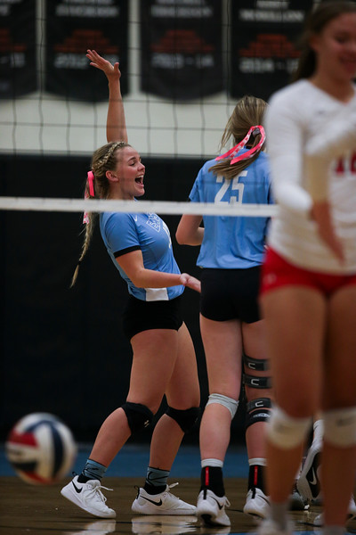 East senior Makylee Buell (13) cheers with her team after scoring a point Thursday, October 10, 2019 at the East High School Thunderdome. Cheyenne East High School Thunderbirds volleyball defeated the the Cheyenne Central High School Indians in straight sets. Nadav Soroker/Wyoming Tribune Eagle