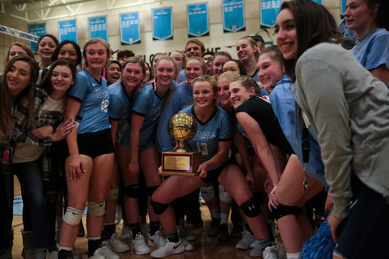 Cheyenne East players hold the Sonja J. Crist Memorial Traveling Trophy in front of their fans Thursday, October 10, 2019 at the East High School Thunderdome. Cheyenne East High School Thunderbirds volleyball defeated the the Cheyenne Central High School Indians in straight sets. Nadav Soroker/Wyoming Tribune Eagle