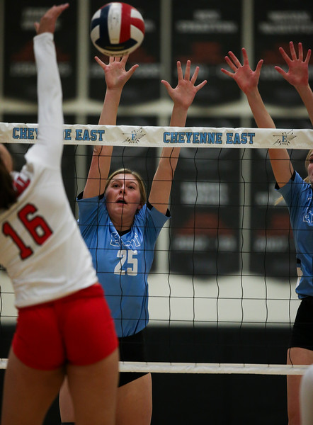 East junior Ashley Marshall (25) blocks a spike from Central sophomore Jordan Jones (16) Thursday, October 10, 2019 at the East High School Thunderdome. Cheyenne East High School Thunderbirds volleyball defeated the the Cheyenne Central High School Indians in straight sets. Nadav Soroker/Wyoming Tribune Eagle