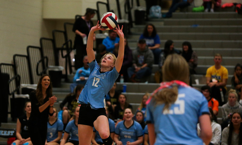 East senior Madison Blaney (12) sets the ball Thursday, October 10, 2019 at the East High School Thunderdome. Cheyenne East High School Thunderbirds volleyball defeated the the Cheyenne Central High School Indians in straight sets. Nadav Soroker/Wyoming Tribune Eagle