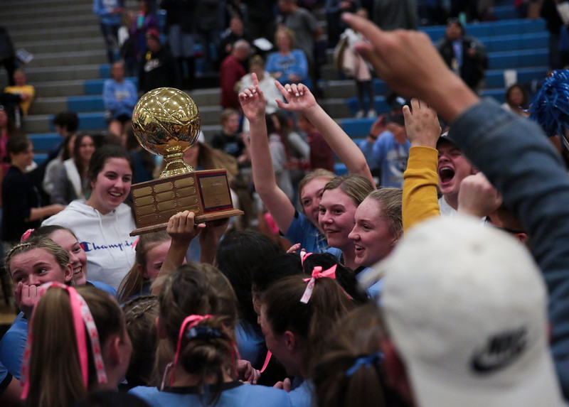 Cheyenne East players lift the Sonja J. Crist Memorial Traveling Trophy in front of their fans Thursday, October 10, 2019 at the East High School Thunderdome. Cheyenne East High School Thunderbirds volleyball defeated the the Cheyenne Central High School Indians in straight sets. Nadav Soroker/Wyoming Tribune Eagle