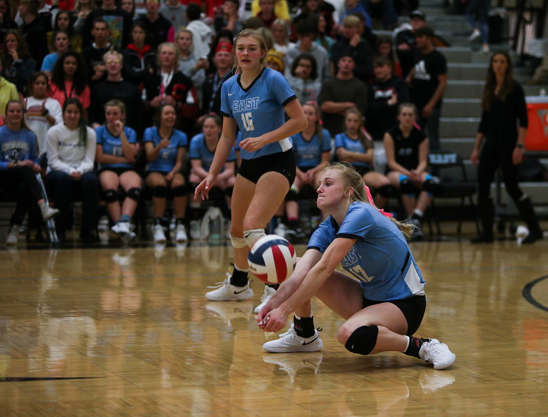 East senior Madison Blaney (12) receives a serve Thursday, October 10, 2019 at the East High School Thunderdome. Cheyenne East High School Thunderbirds volleyball defeated the the Cheyenne Central High School Indians in straight sets. Nadav Soroker/Wyoming Tribune Eagle