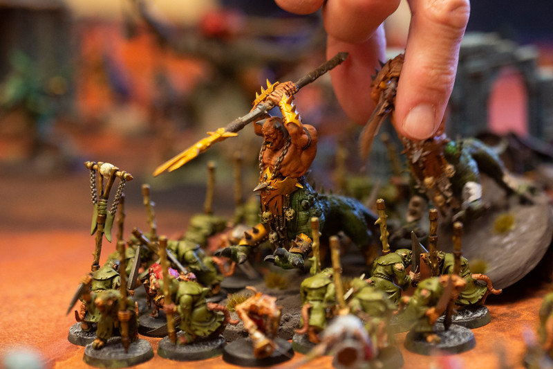 Will Reeves removes a Dragon Ogor during his battle with Greg Goede's figurines in the Warhammer: Age of Sigmar tabletop war game during Olympus Games and Comics' Clash of the Tetons tournament Friday, October 11, 2019 at the Plains Hotel. Clash of the Tetons will continue Saturday with a Warhammer: 40K tournament. Nadav Soroker/Wyoming Tribune Eagle