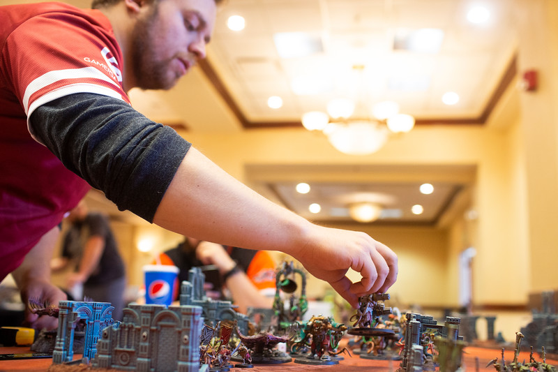 Greg Goede moves figurines in the Warhammer: Age of Sigmar tabletop war game during Olympus Games and Comics' Clash of the Tetons tournament Friday, October 11, 2019 at the Plains Hotel. Clash of the Tetons will continue Saturday with a Warhammer: 40K tournament. Nadav Soroker/Wyoming Tribune Eagle