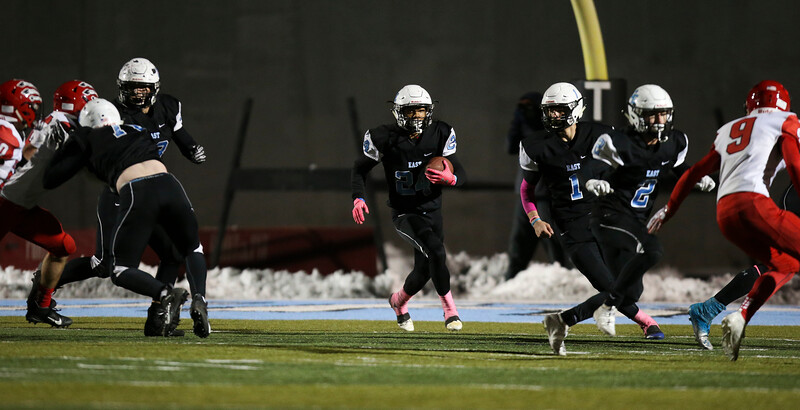 Cheyenne East wide receiver Ox Schroeder (24) runs through an opening Friday, October 11, 2019 at Cheyenne East High School. The Cheyenne East High School Thunderbirds defeated the Cheyenne Central High School Indians 24-21. Nadav Soroker/Wyoming Tribune Eagle